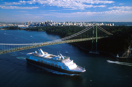 Cruise Ship passes under Lions Gate Bridge at Stanley Park, Vancouver, British Columbia, Canada