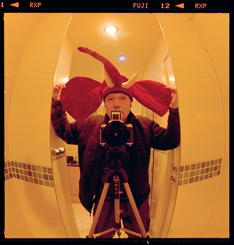 reflected self-portrait with Pentacon Six camera and elephant hat by pho-Tony