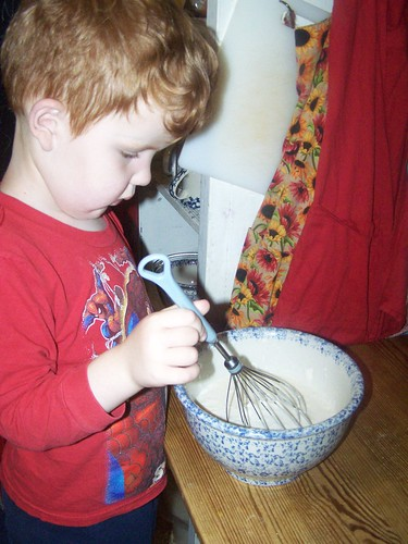 mixing pancakes by Emilyannamarie