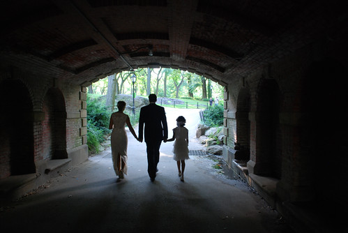 Wedding couple with flower girl, in Central Park