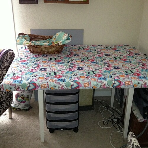 """Husband made me an ironing board that sits over the top of my table! It's nice and big : 38"""" x 52""""!"""