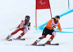Marcoux and Femy enroute to a gold medal in Sochi, RUS during the giant slalom at the 2014 Paralympic Winter Games
