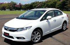 automobile(1.0), automotive exterior(1.0), vehicle(1.0), honda(1.0), bumper(1.0), honda civic hybrid(1.0), sedan(1.0), land vehicle(1.0), honda civic(1.0),