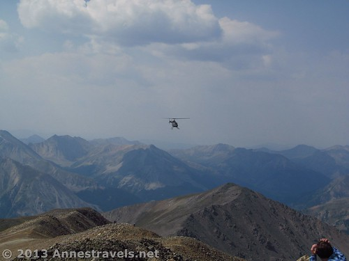 A helicopter circles near the summit of Mount Elbert, San Isabel National Forest, Colorado