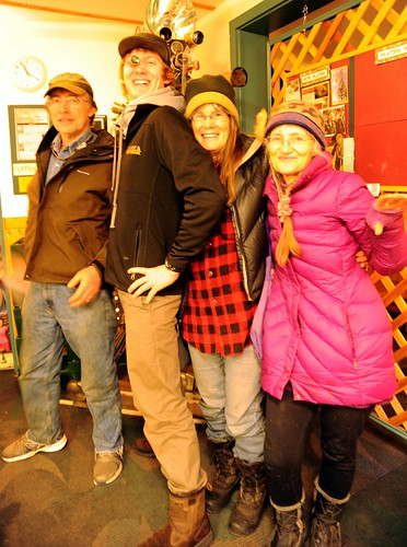 Alaskans: Otto, August (with an eye piece), Charlotte, and Sunrise, Kilcher family, movie camera in back ground, mid-winter, going to see Smaug at the Homer Theatre, Homer, Alaska, USA by Wonderlane