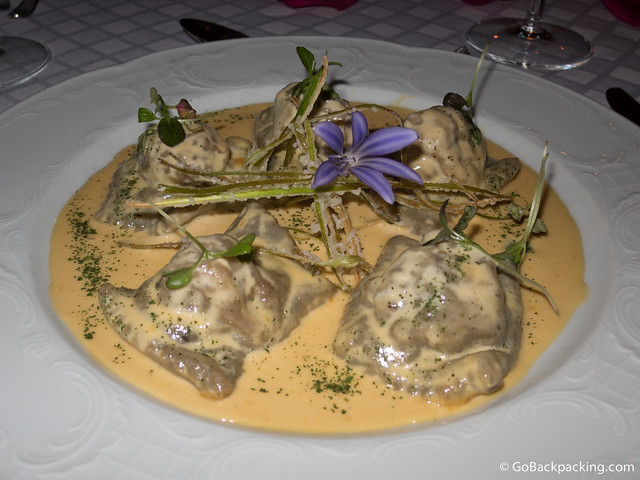 Ravioli in dehydrated forest mushroom dough, stuffed with Lamb in its own juices, flavored with black truffle oil