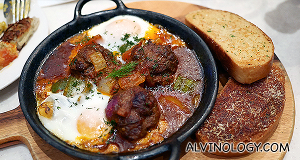 Egg-crowned Shakshouka (Morocco) - Lamb kefta, tomatoes, eggs tagine and garlic toast (S$14.90)