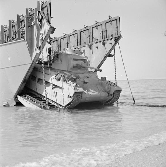 A Matilda tank comes ashore from a landing craft