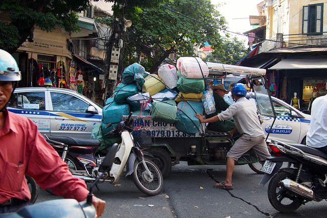 overladen vehicle stuck in traffic, Hanoi, Vietnam