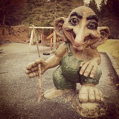 A troll(?) welcoming kids to a nightmarish (to me) playground on a mountaintop