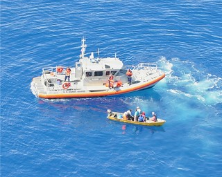 The crew of a Coast Guard Boat Station San Juan 45-foot Response Boat Medium prepares to embark nine Dominican migrants, following an at-sea interdiction by Caribbean Border Interagency Group partner agencies Oct. 8, 2013, approximately 29 nautical miles north of Aguadilla, Puerto Rico. The migrants were transferred to the Coast Guard Cutter Venturous and repatriated Oct. 10, 2013, during an at-sea transfer of the migrants to the Dominican Republic navy patrol boat Proción in waters off the coast of Santo Domingo, Dominican Republic. U.S. Coast Guard photo