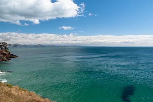 newzealand sky seascape clouds landscape hills pacificocean southisland otago dunedin otagopeninsula taiaroahead tripdownsouth