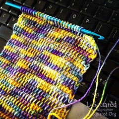 Another in progress shot - showing lots of loops of the current scarf row on the hook.