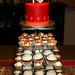 red & orange Indian cake and cupcakes