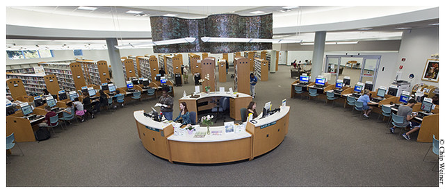 Interior of the Jan Platt library with help desk and public computer terminals