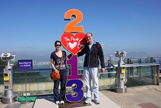 "Mei and Dan at the Peak with a ""2013"" statue"