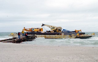 A 180-foot barge is shown beached on Anna Maria Island, Tuesday, April 8, 2014. Watchstanders at Sector St. Petersburg received notification at 2 a.m., April 8 that the operator of tug ABE H was having difficulty steering due to weather, and was unable to control one of the two barges that the tug was pushing approximately one mile west off of Longboat Key. (U.S. Coast Guard photo)