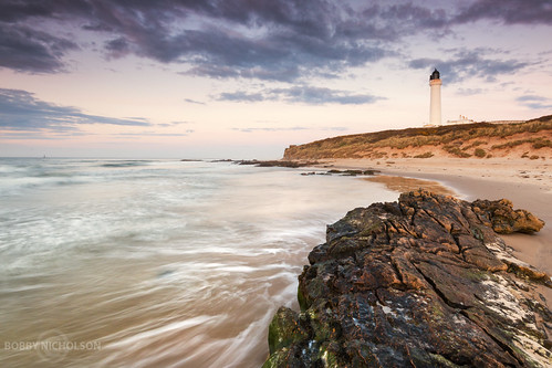 sunset sea lighthouse beach scotland highlands sand rocks moray lossiemouth morayfirth morayshire covesea