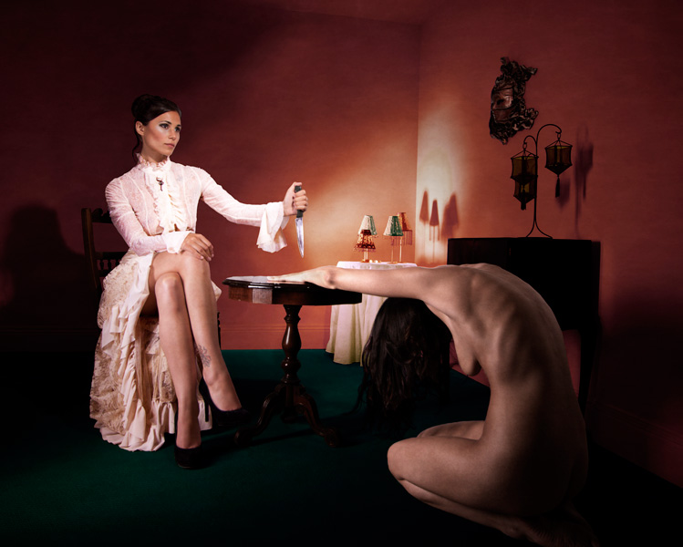 Photograph by Gestalta. A surreal scene of two women playing knife games