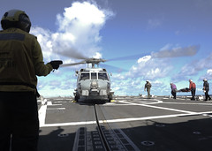 Sailors assigned to USS Shoup (DDG 86) and Helicopter Maritime Strike Squadron (HSM) 35 transport a Sailor for medical evacuation on the ship's flight deck. (U.S. Navy/MC2 Eli K. Buguey)