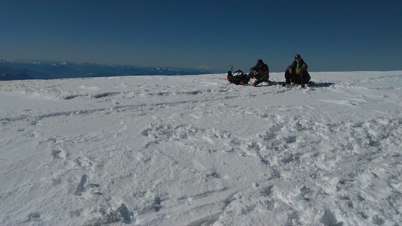 Resting on the summit snowfield