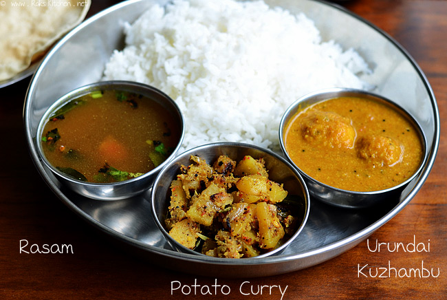 Urundai kuzhambu, rasam and potato curry with rice, appalam