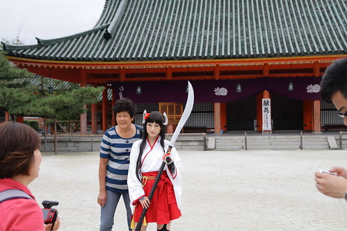 Tourist taking photo with cute cosplayer at Heian Shrine