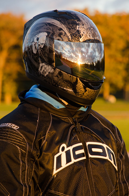 Sunset and clouds reflected in the visor