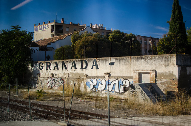 Graffiti seen when entering Granada by train.