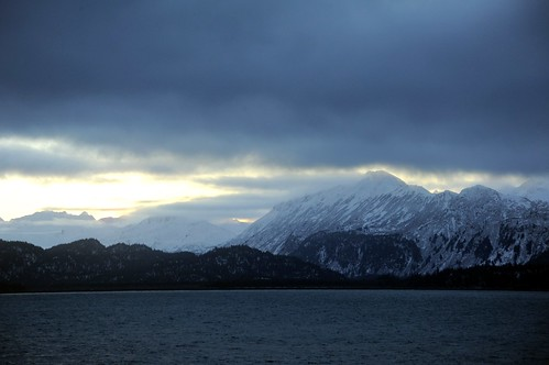Deep blues and gray whites of the Kenai Pennisula Mountain Range, winter, over Katchemak Bay, off Homer Spit, Homer, Alaska, USA by Wonderlane