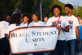 Students pose with a Black Student Union sign.