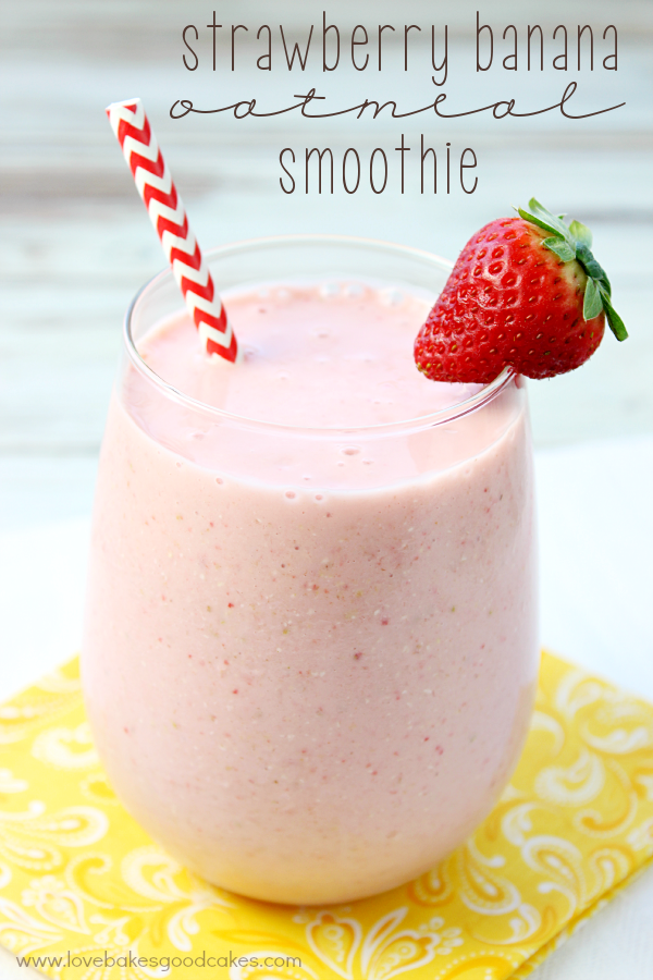 Strawberry Banana Oatmeal Smoothie in a glass with a strawberry and a straw.