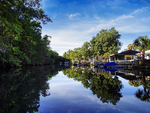blue usa house color reflection green water river landscape dock day unitedstates florida cloudy kayaking manmade features crystalriver