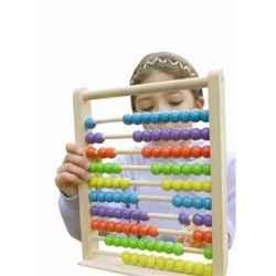 Young girl with abacus toy