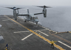The first MV-22 Osprey to be embarked with a ship in the U.S. 7th Fleet area of operations lands on the flight deck of the amphibious assault ship USS Bonhomme Richard (LHD 6) in the East China Sea, June 14. (U.S. Navy photo by Mass Communication Specialist Seaman Apprentice Edward Guttierrez III)