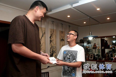 June 27th, 2013 - Yao Ming delivers the tickets to the winner of a ticket lottery for his Foundation's charity game a few days later