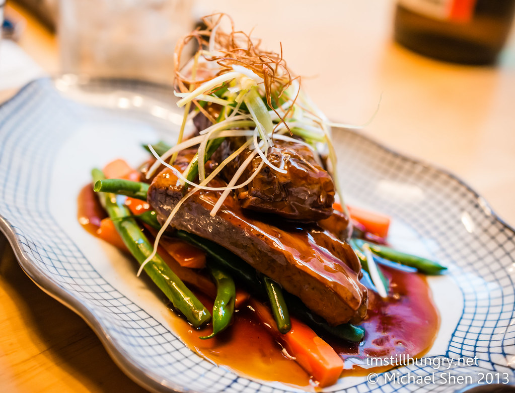 Kuki tanuki Tender buta pork ribs - marinated in a teriyaki sauce & served w/seasonal veggies