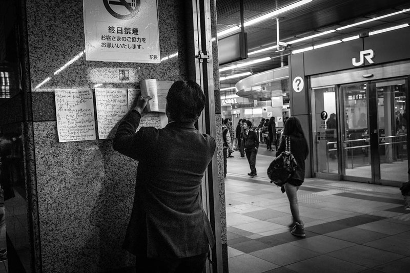 Man doing complex math at Shinjuku Station.