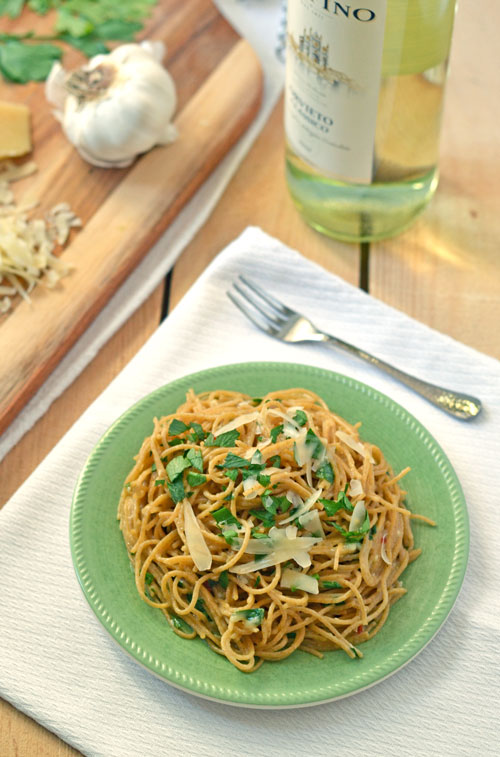Garlic Pasta on a green plate topped with Parmesan cheese