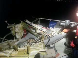 Wreckage of the plane that crashed off the coast of Fort Lauderdale, Fla., is brought aboard a Coast Guard boat Tuesday, Nov. 19, 2013. Search and rescue crews from the Coast Guard, Florida Fish and Wildlife Conservation Commission and local police and fire rescue departments continue to search for possible survivors. U.S. Coast Guard photo.