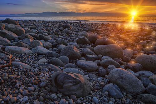 sunset whidbeyisland sunburst pugetsound straitofjuandefuca shinglebeach sunbursts fortebeystatepark pointpartridge