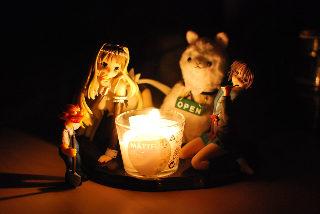 Groundskeeper Willy, Kusugara Sasara, Mr Alpaca Coffee and Nagato Yuki around an IKEA candle
