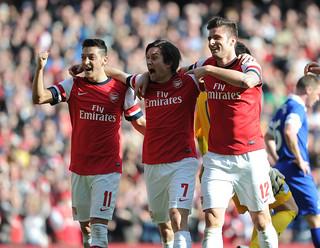 Olivier Giroud, Tomas Rosicky and Mesut Ozil of Arsenal