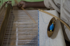 White cotton cloth being made on a traditional weaving loom. Credit: Salima Punjani/IPS