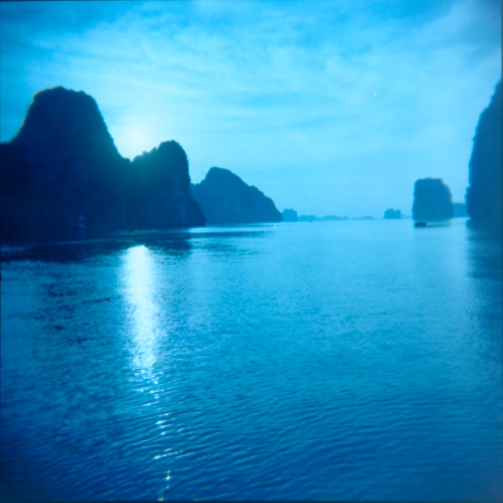 Taken with Holga CFN with Kodak Ektacolor 160. halong bay vietnam blue sea hills mountain water sky ektacolor travel holga lomography photography