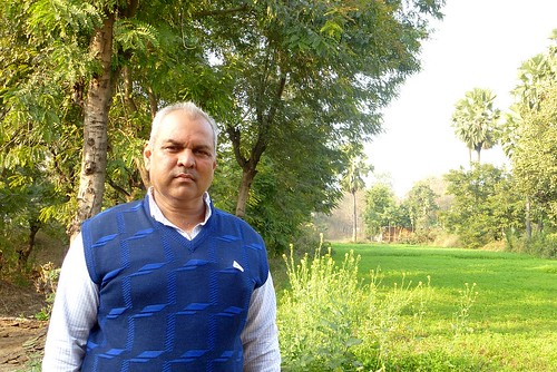Vadehi sharma against a background of  fields and trees