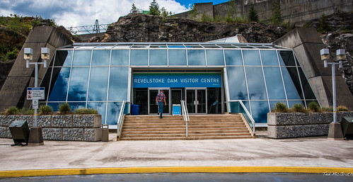 people reflection sign clouds nikon dam steps cropped railing vignetting curb retainingwall visitorcentre 2016 bchydro revelstokedam tedmcgrath cans2s tedsphotos nikonfx peopleandpaths nikond750 revelstokedamvisitorcentre