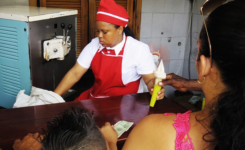 Lady serving ice-cream on the street