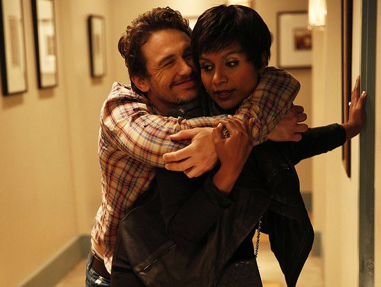 Mindy Lahiri carries a drunken Dr. L back to his apartment in The Mindy Project.
