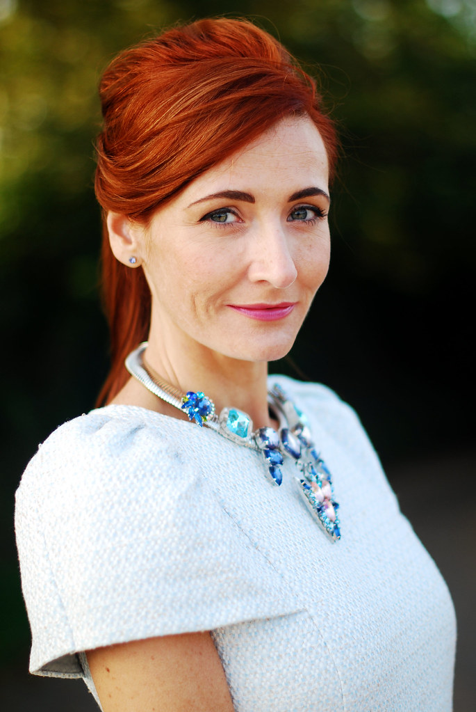 Statement necklace, pale blue dress & red hair
